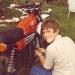 John repairing motorcycle.